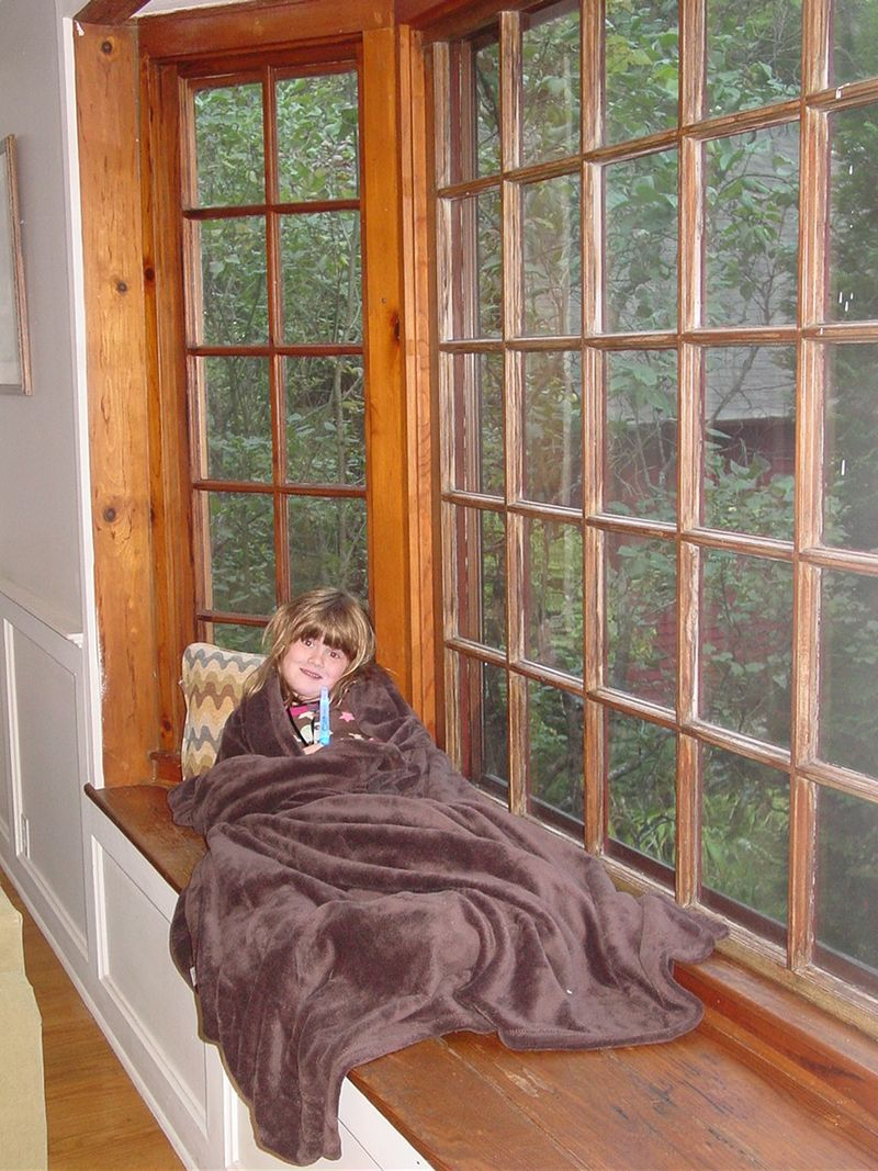 Ella by the picture window